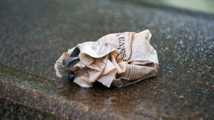 CrumbledNewspaperOnSidewalk